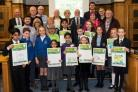 Winners of the Greening Grey Britain 'design a poster' and gardening competitions awarded a Bury town hall by Mayor Dorothy Gunther
