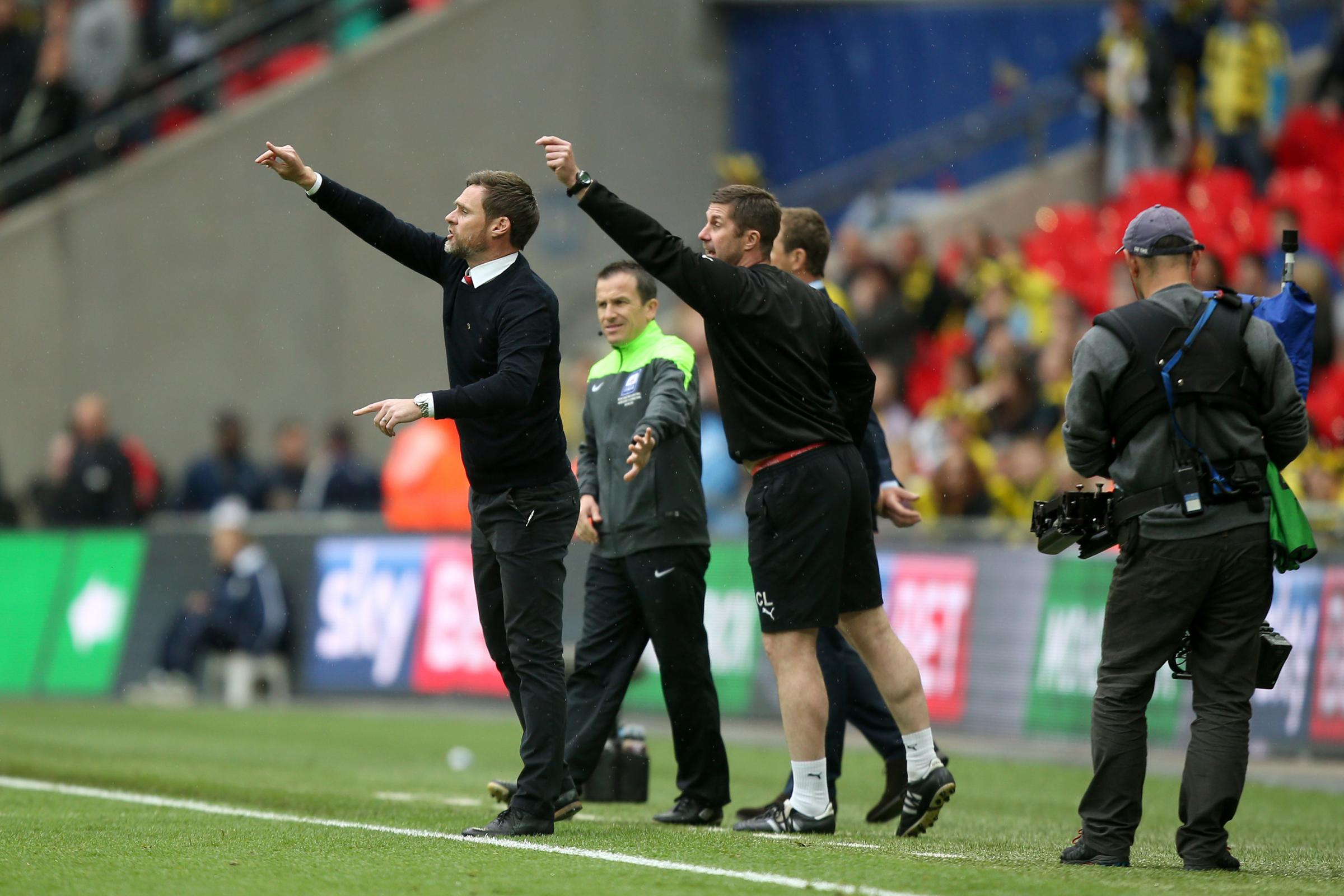 Chris Lucketti, right, on the touchline with Graham Alexander, has been named manager of the Shakers