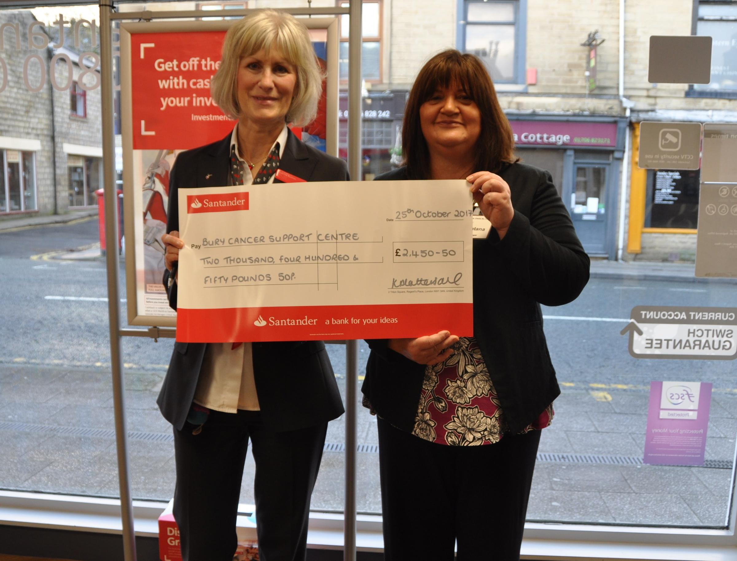 Trina Buxton,  Santander Ramsbottom presents Jan Katana Manager at Bury Cancer Support Centre with a cheque