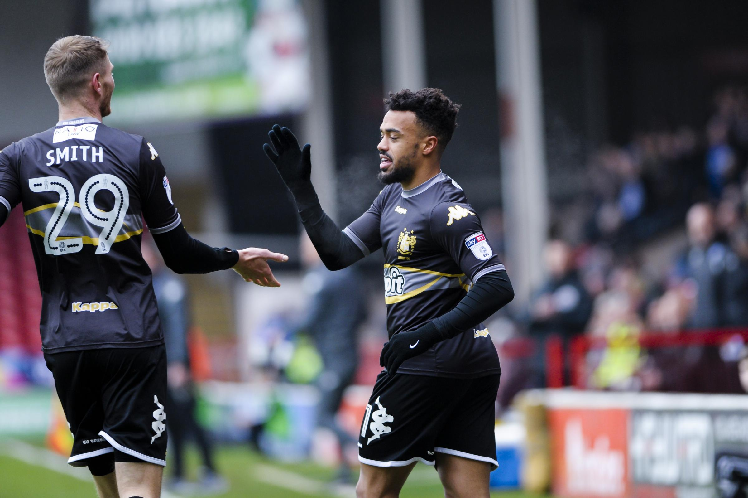 HOWDY PARTNER: Nicky Ajose celebrates with strike partner Michael Smith after opening the scoring at Walsall