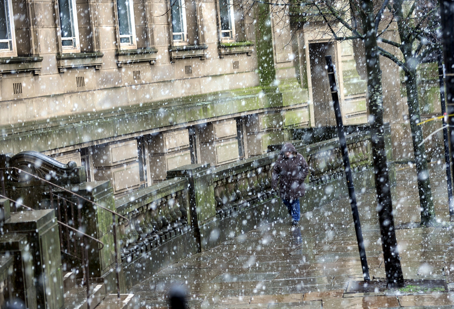 Snow falls in Bolton Town centre on the last day of February.