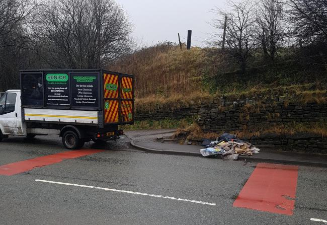 A Senior Waste Removal van dealing with fly-tipped waste on the A56