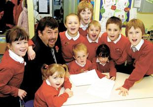 Bury Times: Headteacher Tim Power with pupils from Emmanuel Holcombe