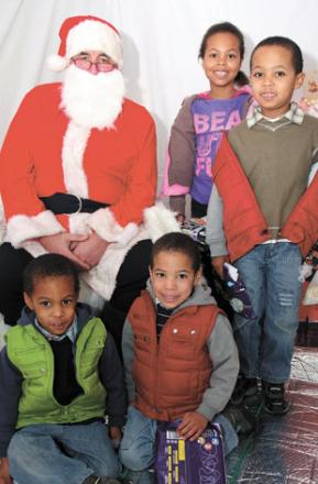 Meeting Father Christmas are Naomi Jung (7) and Nils Jung (5), and three-year-old twins Nathan and Noel Jung