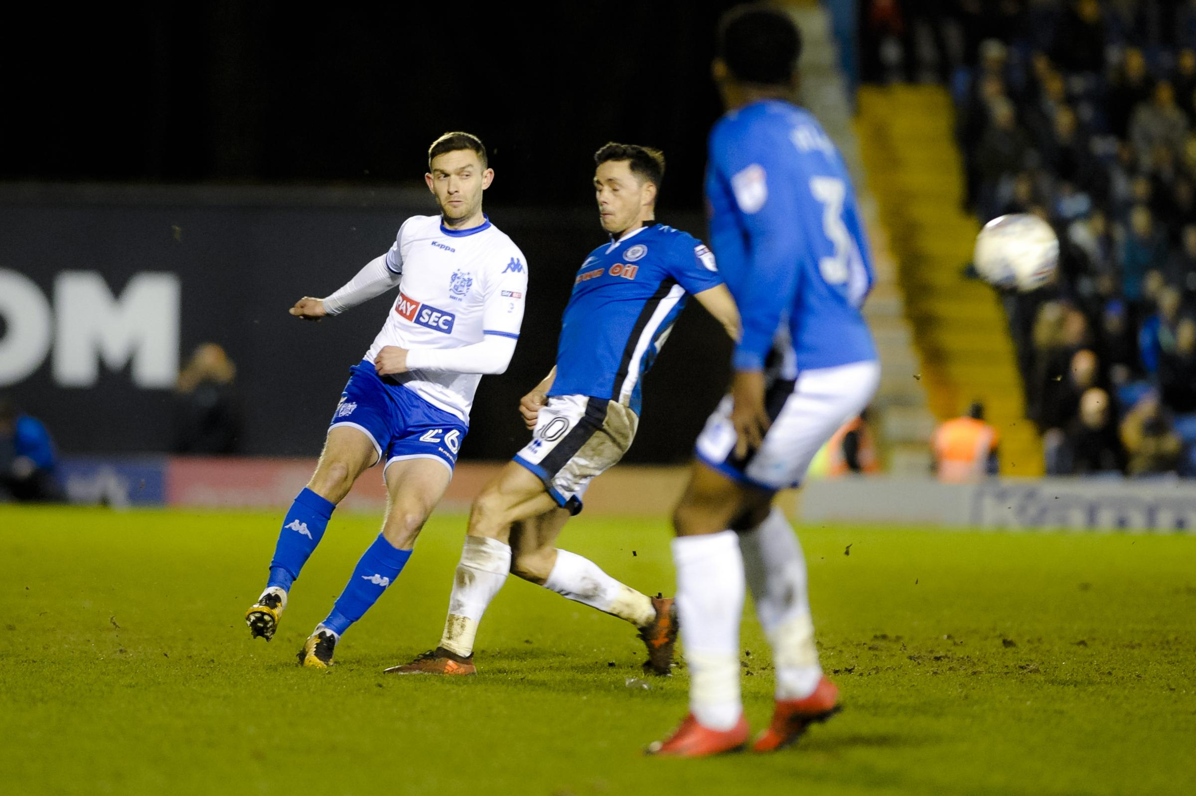 Bury midfielder Jay O'Shea under pressure from Rochdale forward Ian Henderson. Picture: Andy Whitehead