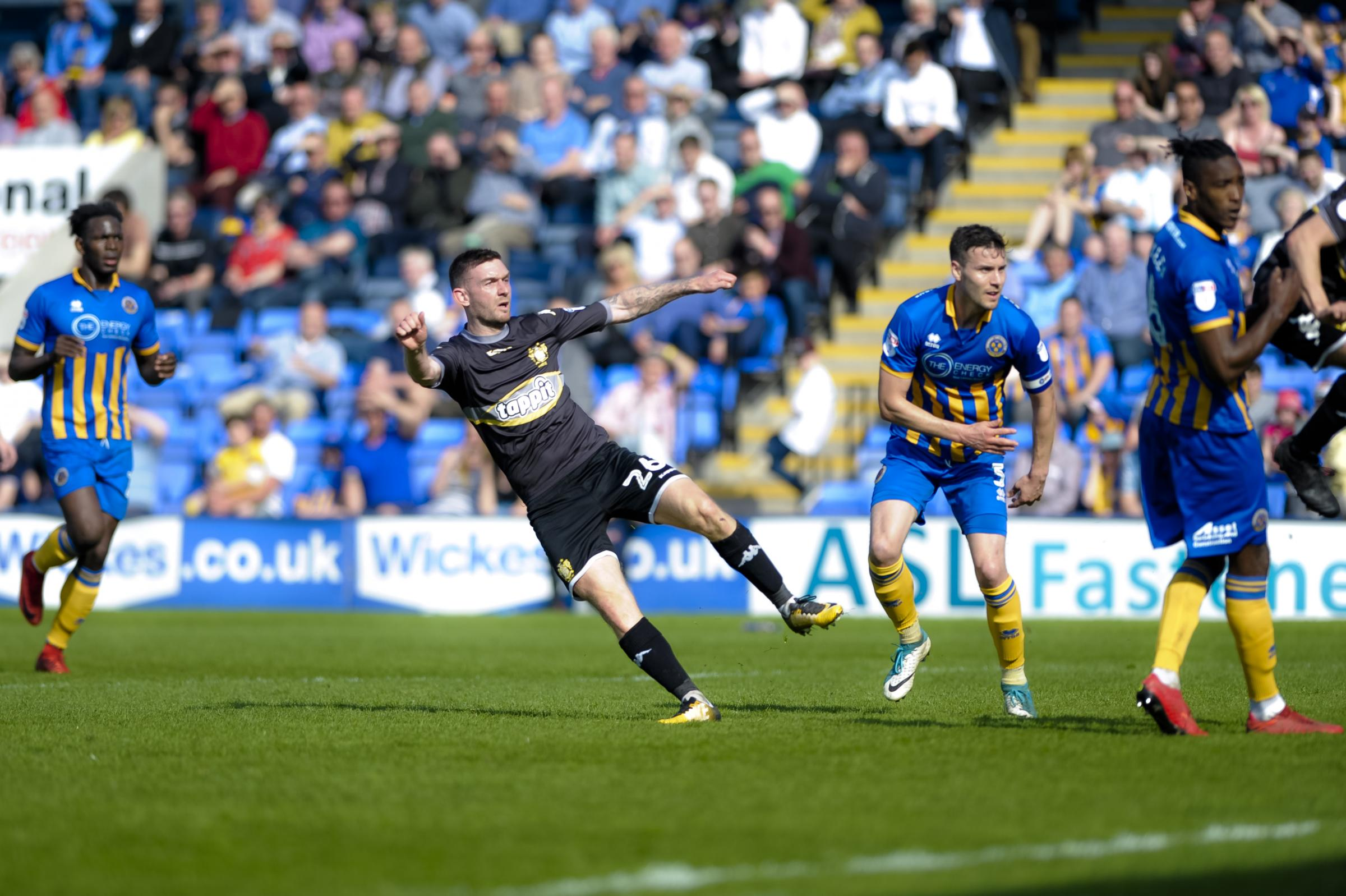 Bury midfielder Jay O'Shea equalises against Shrewsbury Town. Picture by Andy Whitehead