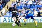 Bury midfielder Jay O'Shea goes past Shrewsbury Town defender Matthew Sadler. Picture by Andy Whitehead