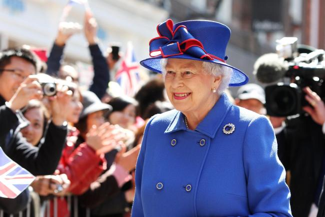 Bets on for Queen s hat colour at royal wedding. Ladbrokes set blue as the  favourite colour for the Queen s hat on May 19 (Chris d5425204698f