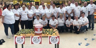 Staff from Tesco, Bury, fundraising for We Love Manchester Emergency Fund