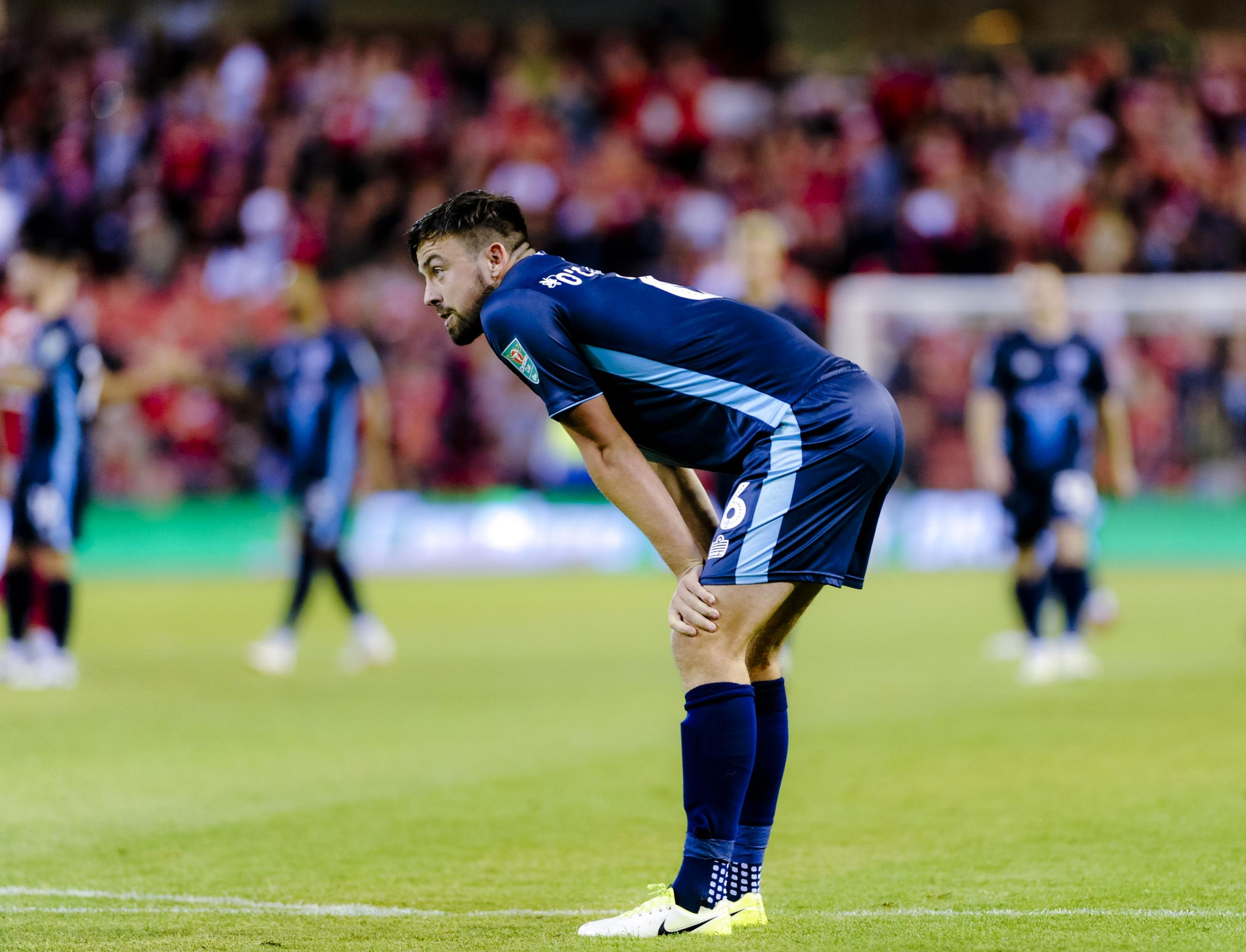Bury defender Eoghan O'Connell after missing his penalty during the shoot out at the end of the Carabao Cup Round 1 match between Nottingham Forest and Bury FC at The City Ground. Picture by Andy Whitehead