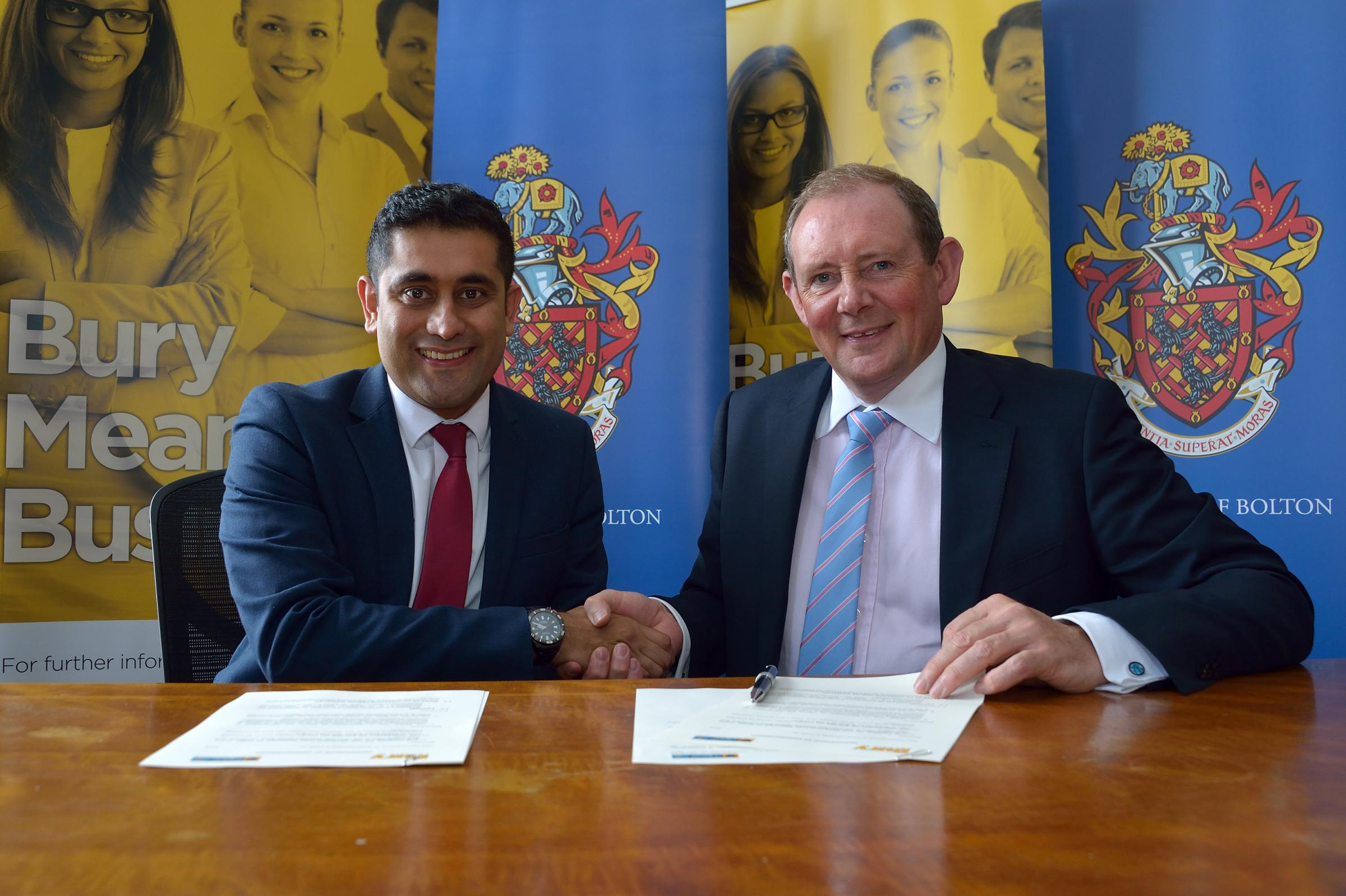 Leader of Bury Council, Cllr Rishi Shori, and president and vice chancellor of The University of Bolton at the memorandum signing