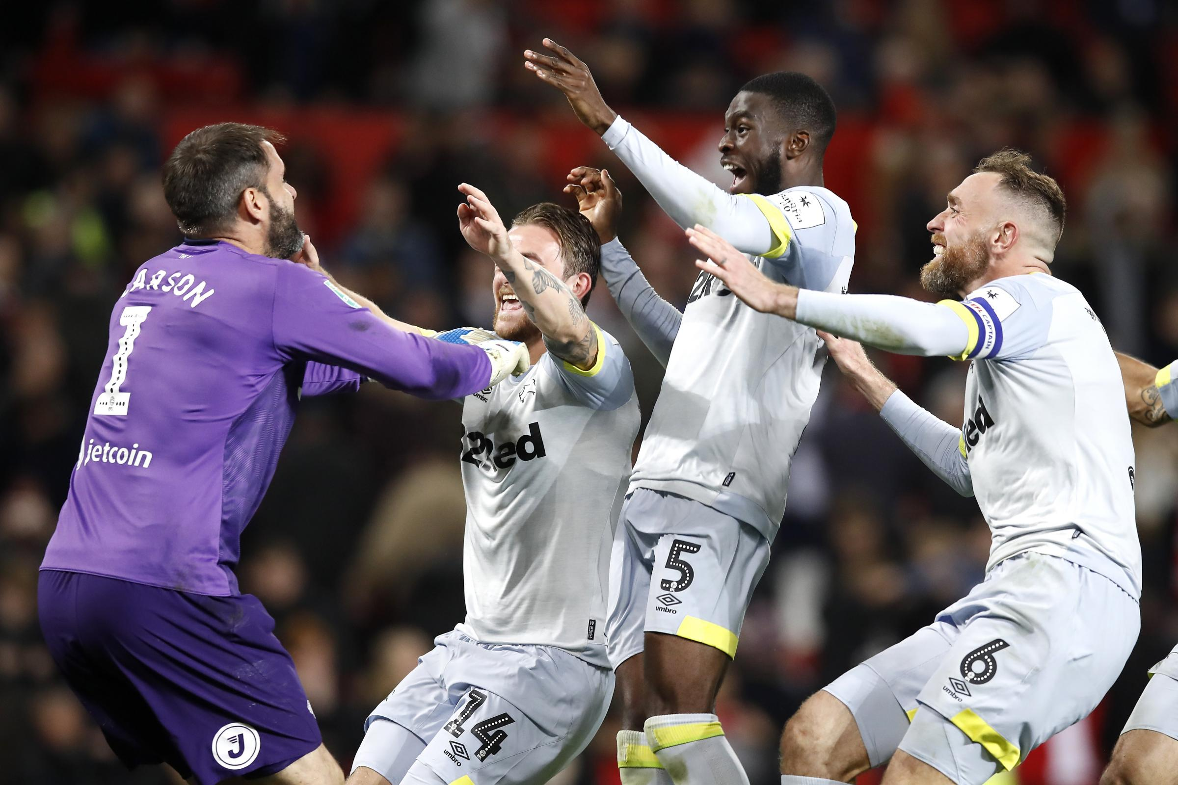 Scott Carson, left, celebrates with his Derby team-mates
