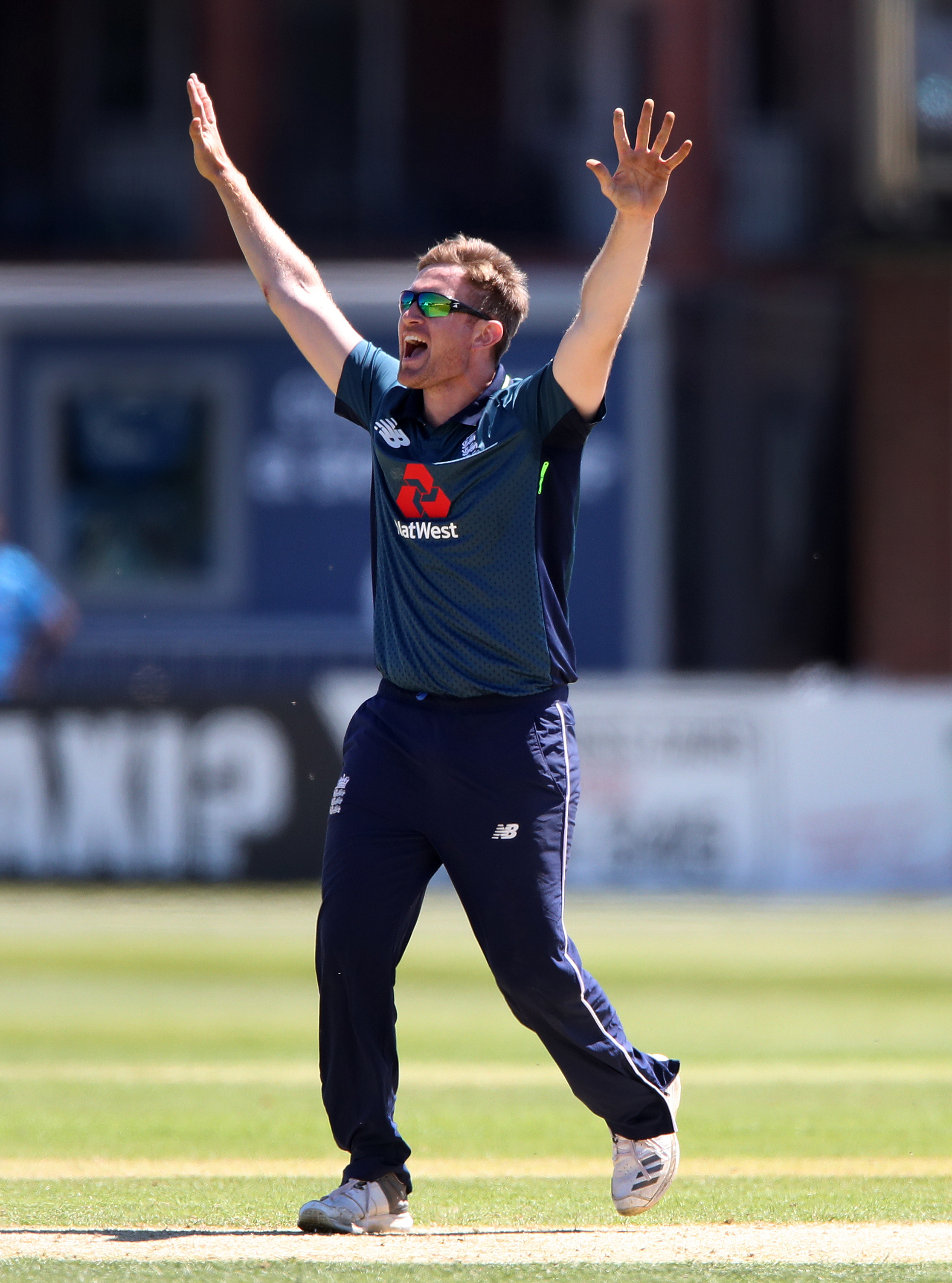 England Lions bowler Liam Dawson celebrates trapping India A batsman Krishnappa Gowtham during the Tri Series match at the 3aaa County Ground, Derby..