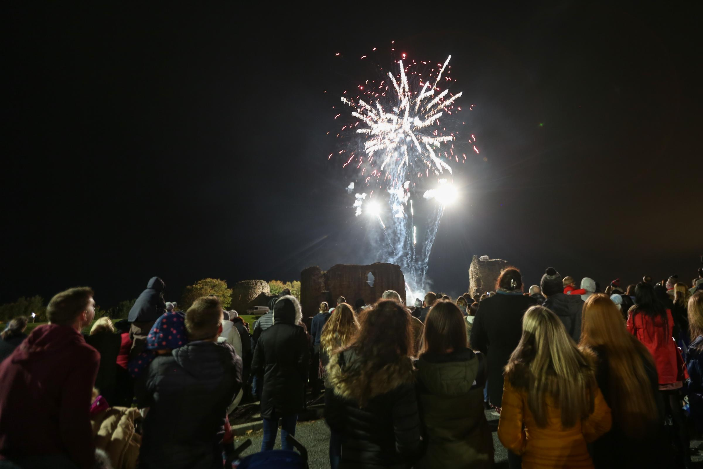 Flint RNLI hold a fireworks display at Flint Castle. Pic: Hundreds of people enjoy the fireworks display at Flint Castle. GA021118E.