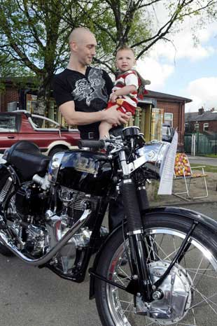 Glen Ratcliffe and Theo Ratcliffe, aged two, with a vintage 1966 Velocette motorbike