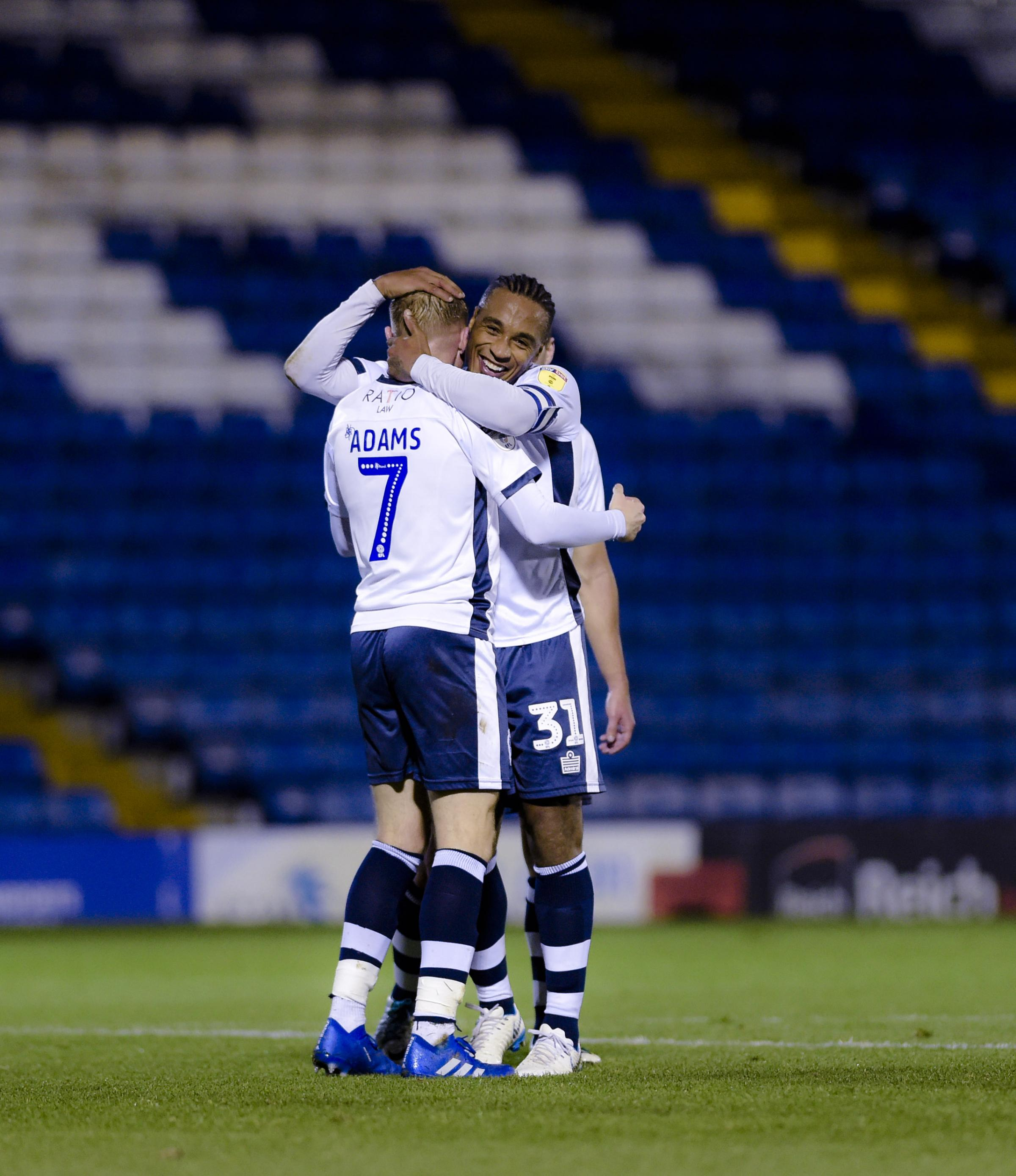 Midfielder Nicky Adams celebrates with Neil Danns after making it 3-1 to Bury during the Checkatrade Trophy match between Bury FC and Fleetwood Town. Picture by Andy Whitehead
