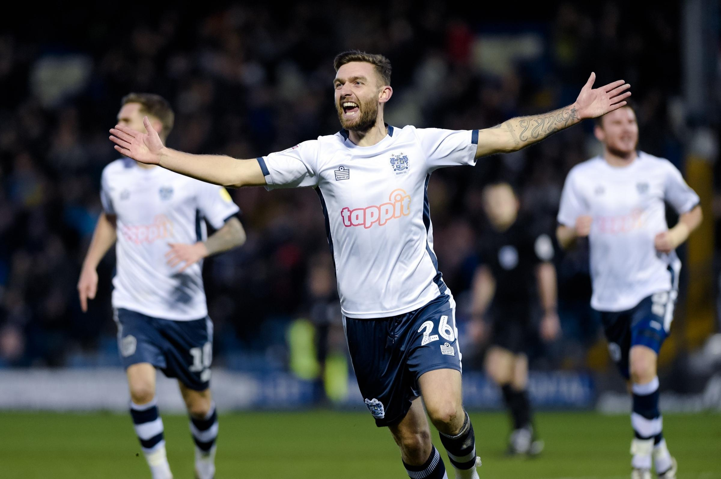 GOAL: Bury midfielder Jay O'Shea celebrates after opening the scoring against Stevenage. Picture by Andy Whitehead Photography