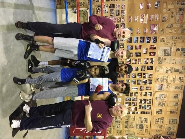 QUARTET: Bury ABC boxers, back, from left, Kian Winstanley, Ali Akbar Javid, Abdul Khan; front, Reece Khan, with coaches Mick Jelley, left, and Colin Carr