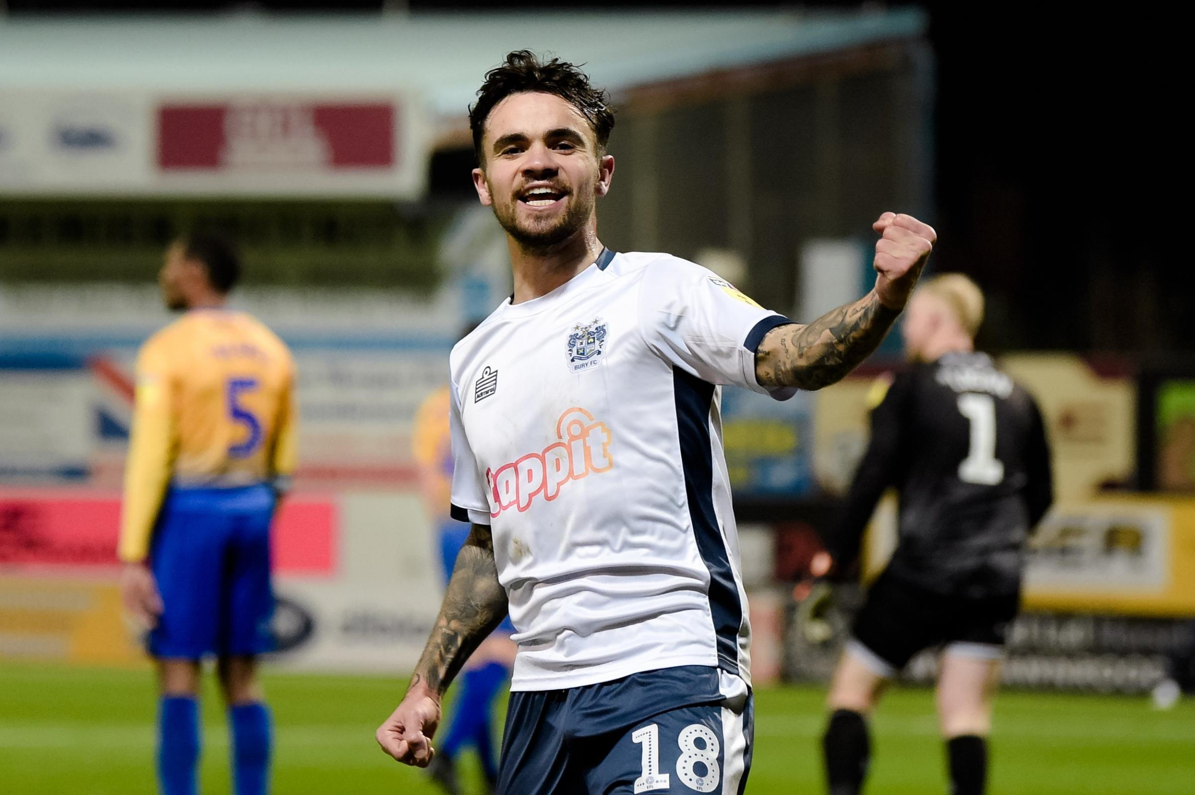 DOM JOLLY: Bury's Dominic Telford celebrates his winning goal at Mansfield