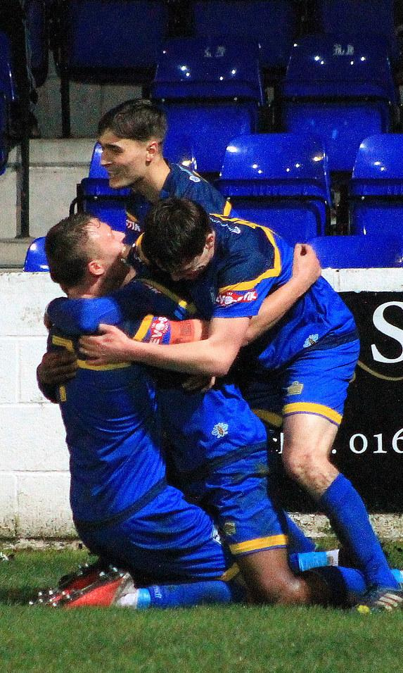 BLUE HEAVEN: Boro players celebrate during the win against Atherton Collieries