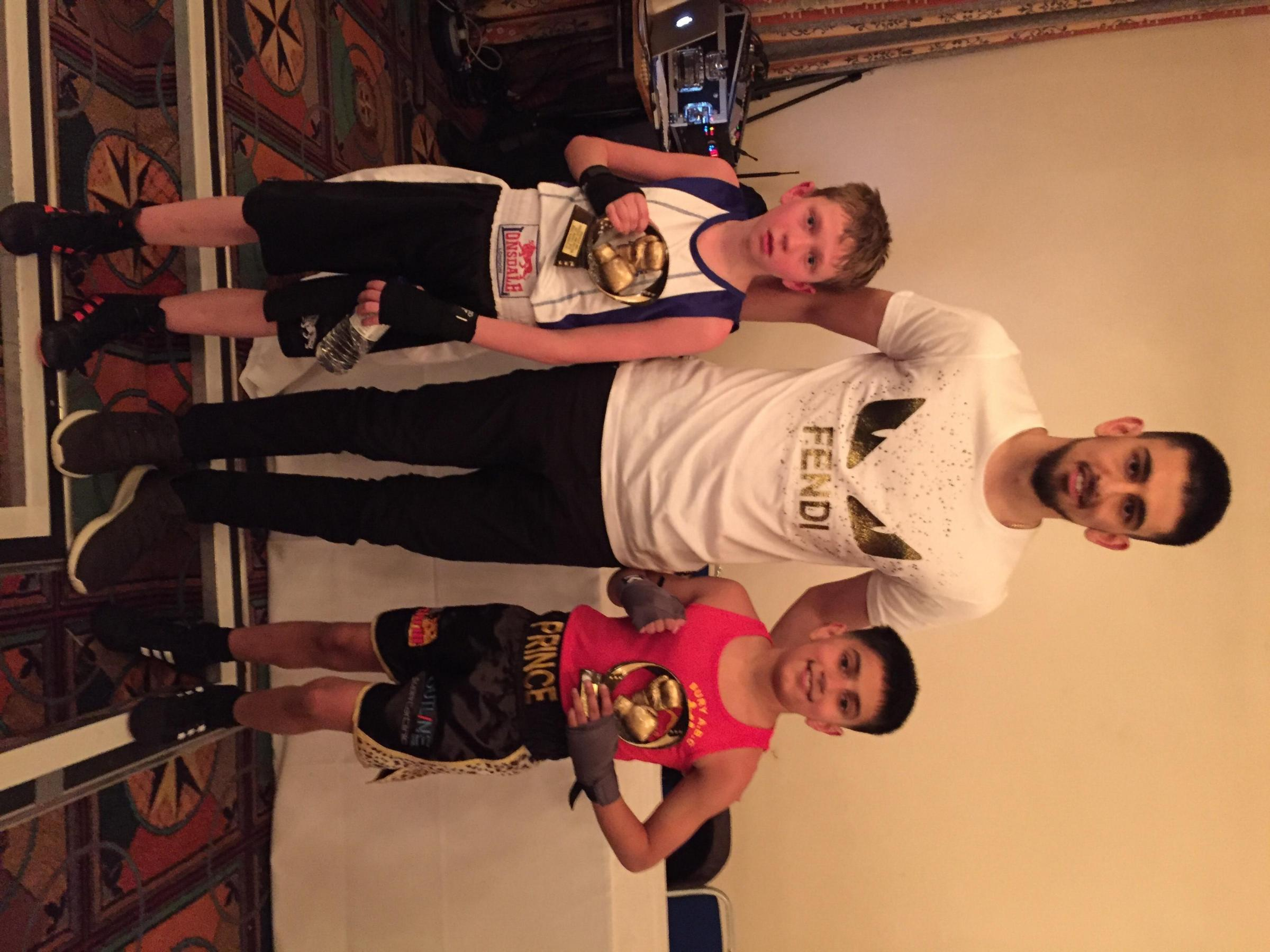 WINNER: Bury ABC's Reece Khan, right, with Jason Bubbins, left, and former Bury ABC fighter Sahir Iqbal