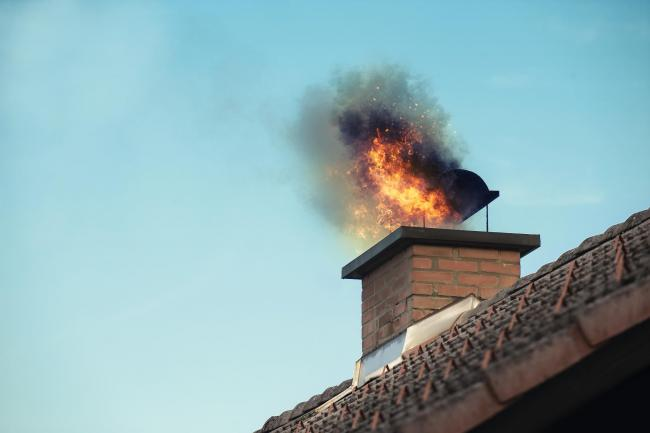 File picture of chimney with fire coming out.