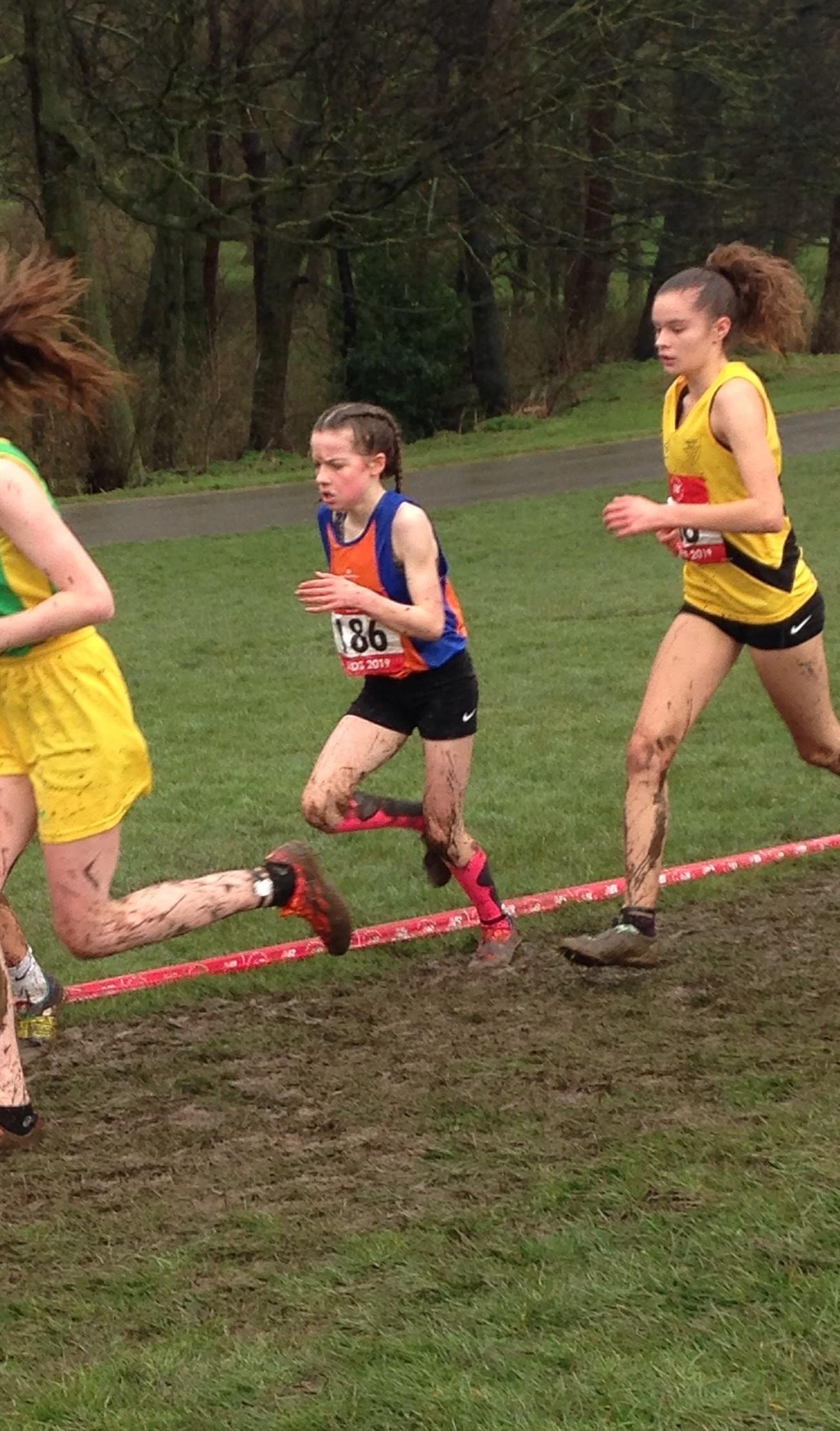 FIRST TIMER: Freya Potts (orange and blue vest) running in the English Schools cross country championships