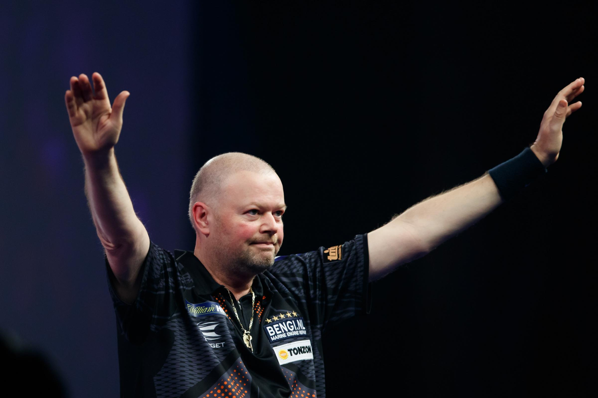 Raymond van Barneveld boosted his survival hopes in Berlin