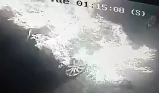 A CCTV still shows the car completely engulfed in flames