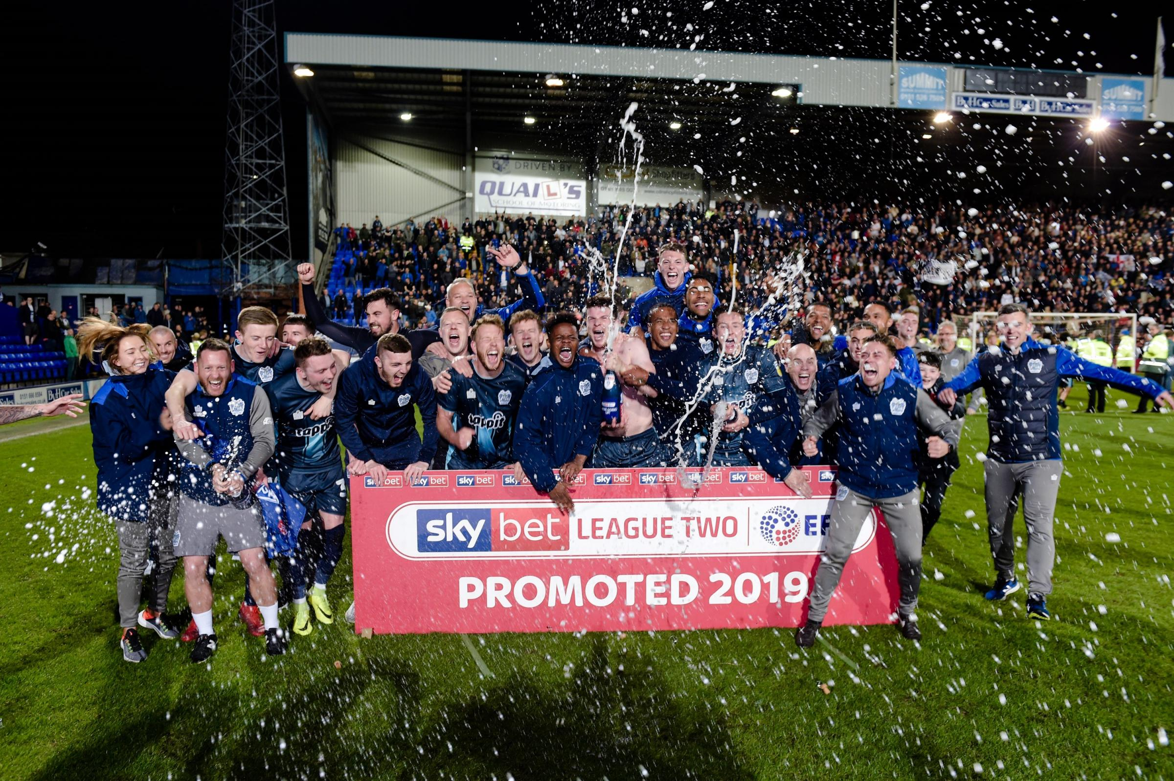 Bury celebrate sealing promotion at Tranmere. Picture: Andy Whitehead  Phootgraphy