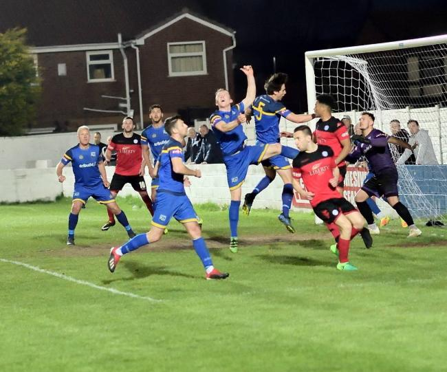 DERBY CLASH: Action from Radcliffe Boro's 3-0 victory against Ramsbottom United in the play-off semi-final. Picture by Frank Crook
