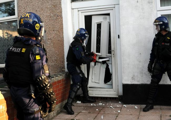 Police raid home in Chesham Road as part of dawn crackdown